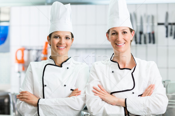 chefs wearing working clothes in industrial kitchen Stock photo © Kzenon