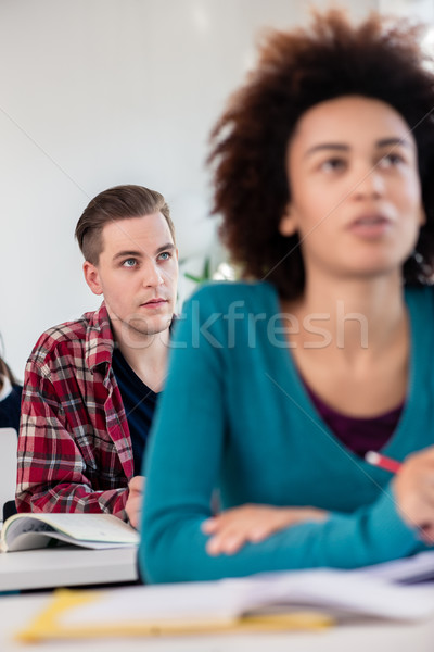 Student smiling while using a tablet during class in a modern co Stock photo © Kzenon
