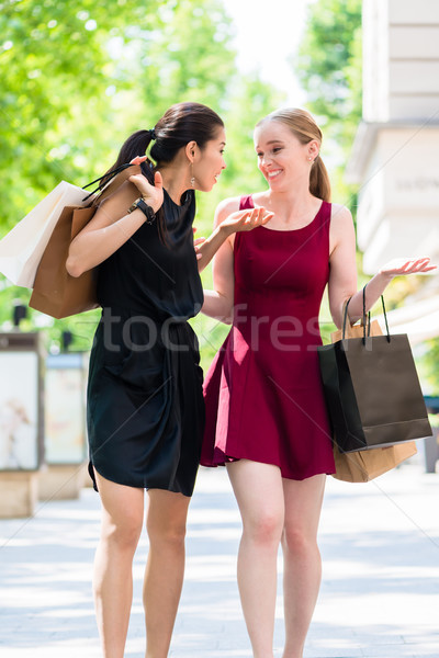 Stock photo: Two beautiful women looking for fashion boutiques during shoppin