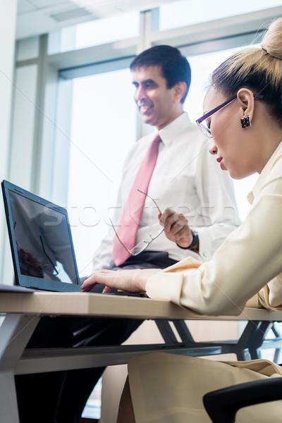 Senior professional giving advise to his junior subordinate  Stock photo © Kzenon