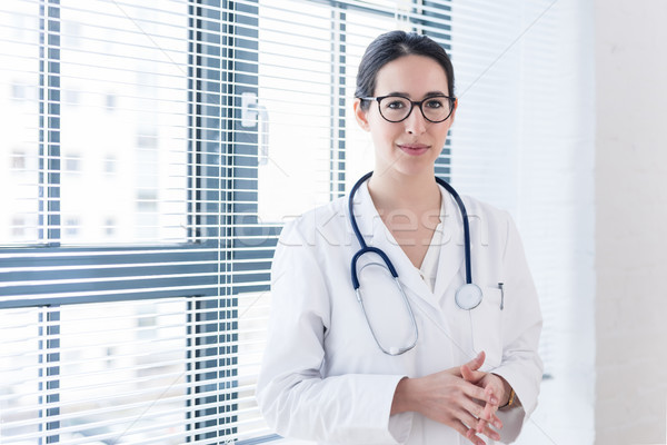 Portrait of a young nurse or physician looking at camera with co Stock photo © Kzenon