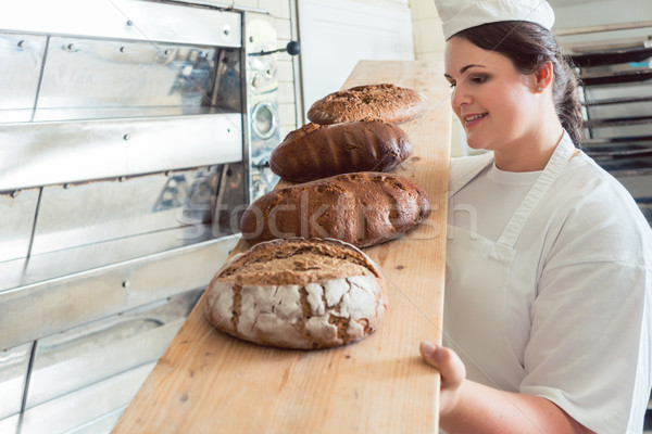 Fresh bread on a board in bakehouse of bakery Stock photo © Kzenon