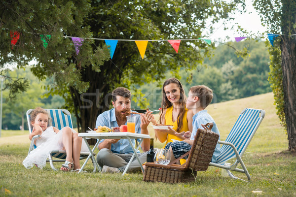 Dedicated parents of two children listening to their son talking Stock photo © Kzenon