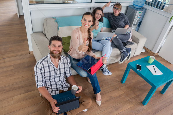 young people sharing a collaborative office space in a modern hub Stock photo © Kzenon