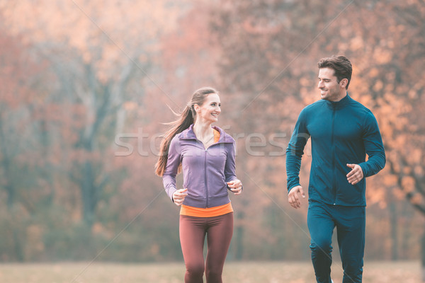 Couple in wonderful fall landscape running for better fitness Stock photo © Kzenon