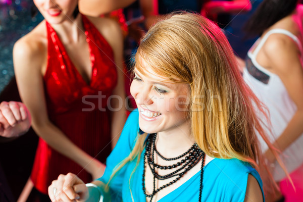 Young people dancing in club or disco, men and women Stock photo © Kzenon