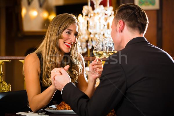 Heureux couple romantique date restaurant Photo stock © Kzenon