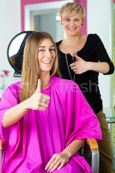 Woman at the hairdresser getting advise Stock photo © Kzenon