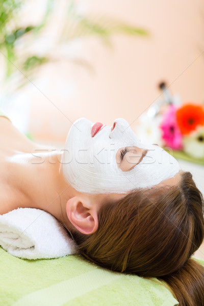 Stock photo: Wellness - woman getting face mask in spa
