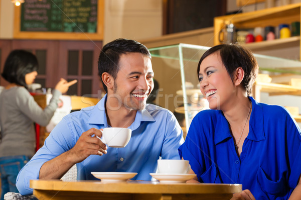 Asian woman and man in an coffee shop Stock photo © Kzenon