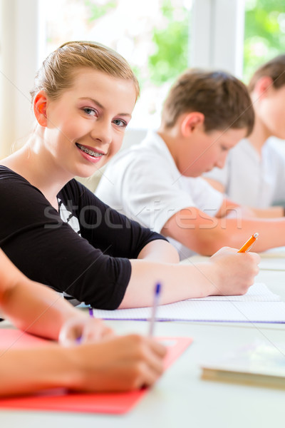 Students writing a test in school concentrating Stock photo © Kzenon