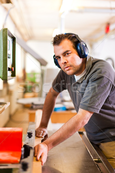 Stock photo: Carpenter with electric cutter