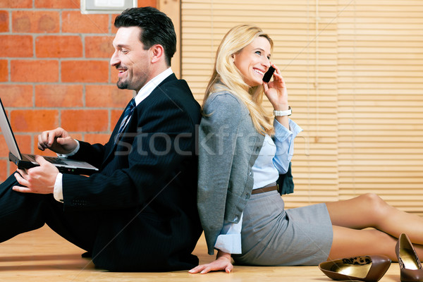 Business couple is working at home Stock photo © Kzenon