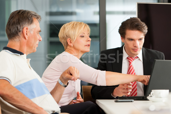 Mature couple with financial consultant Stock photo © Kzenon