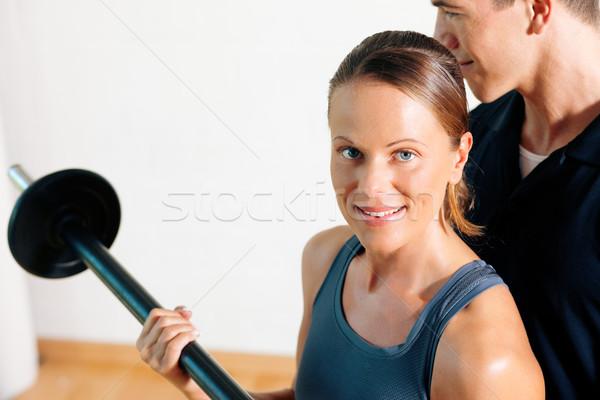 Personal Trainer in gym Stock photo © Kzenon