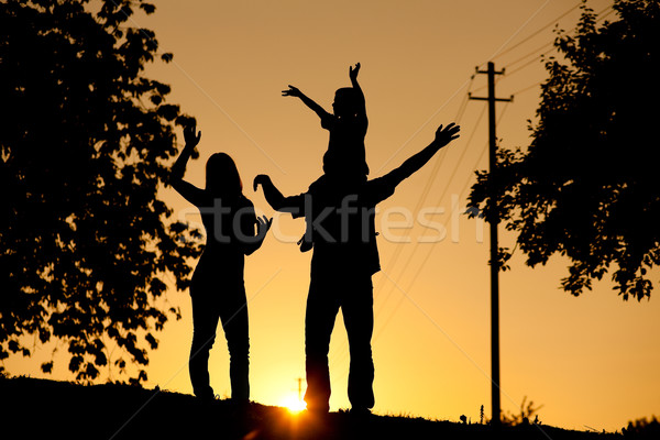 Family having walk at sunset Stock photo © Kzenon