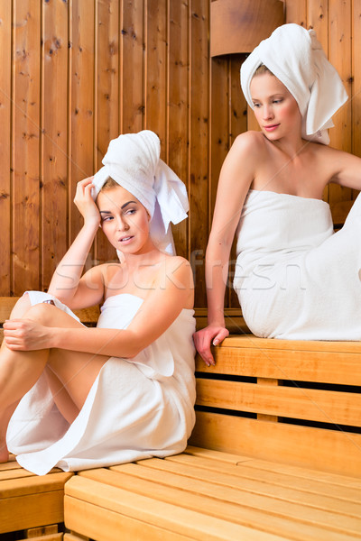 Two women in wellness spa enjoying sauna infusion Stock photo © Kzenon
