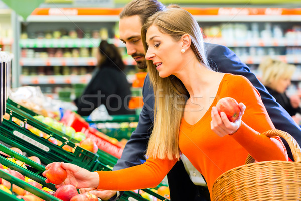 Couple selecting fruits in hypermarket Stock photo © Kzenon