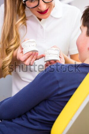 Doctor taking blood sample Stock photo © Kzenon