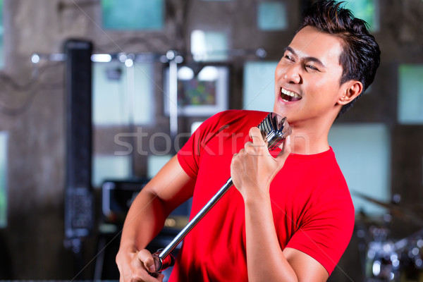 Asian singer producing song in recording studio Stock photo © Kzenon