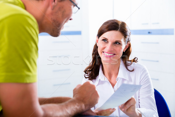 Patient at reception of doctors office  Stock photo © Kzenon