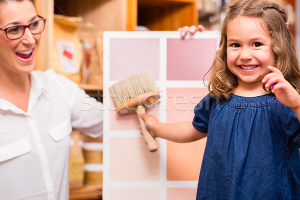 Family with paint sample card in store Stock photo © Kzenon