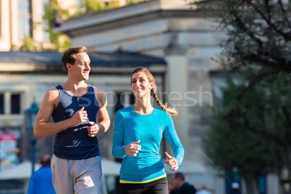Couple running in Dresden inner city Stock photo © Kzenon