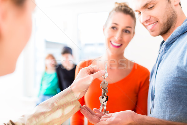 Accommodation broker giving home key to family Stock photo © Kzenon