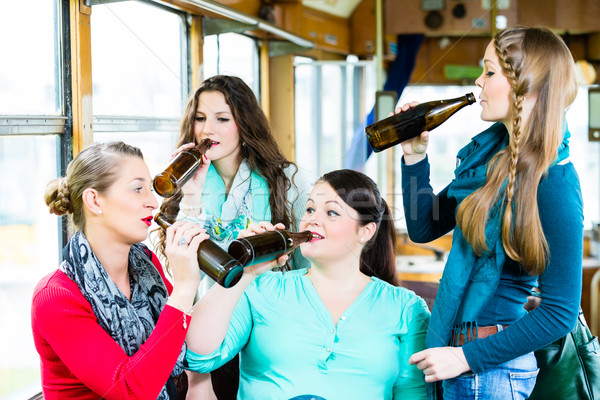 Group of people in tram bar having beer party Stock photo © Kzenon