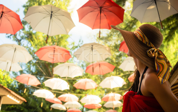 Female tourist marvels at baldachin of umbrellas  Stock photo © Kzenon