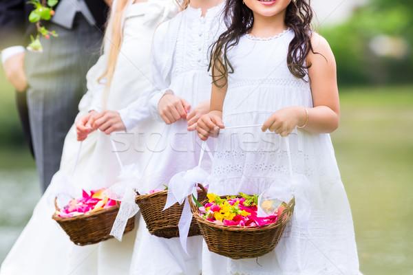 Wedding bridesmaids children with flower basket Stock photo © Kzenon