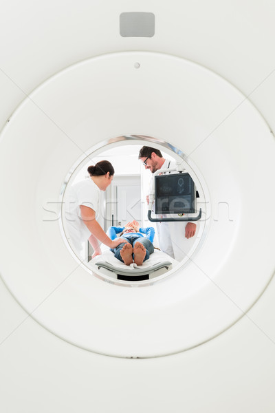 Doctor, nurse, and patient at CT scan Stock photo © Kzenon