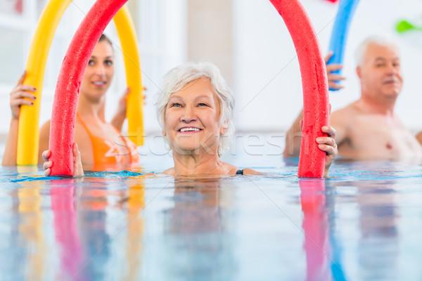 группа фитнес Бассейн молодые старший люди Сток-фото © Kzenon