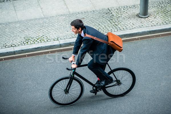 Moço negócio terno equitação utilidade Foto stock © Kzenon