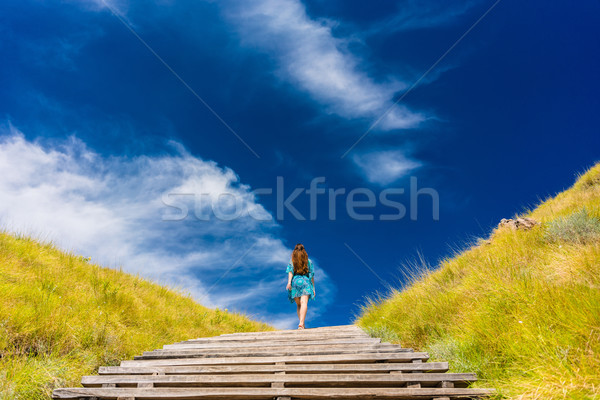 Young woman climbing stairs outdoors in an idyllic travel destin Stock photo © Kzenon