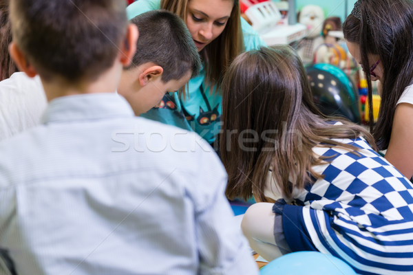 Group of kids applying colorful plasticine during educational ac Stock photo © Kzenon