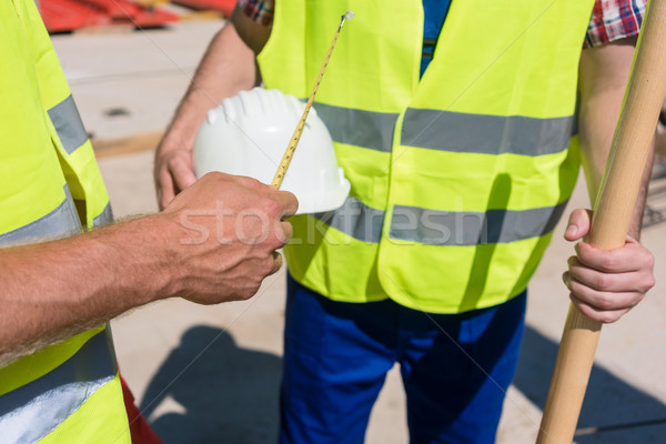 Close-up of the hand of a worker holding a measuring tape next t Stock photo © Kzenon