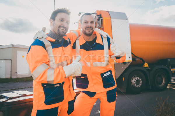 Garbage removal workers giving a thumbs-up Stock photo © Kzenon