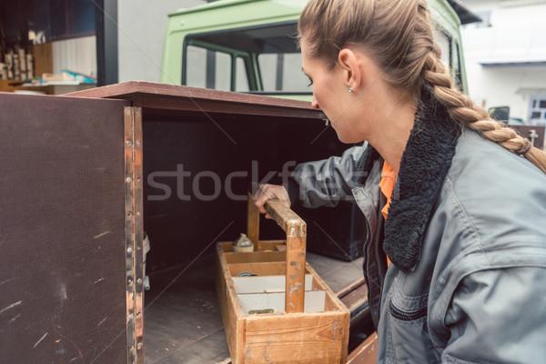 Woman carpenter loading tools in mobile workshop transporter Stock photo © Kzenon