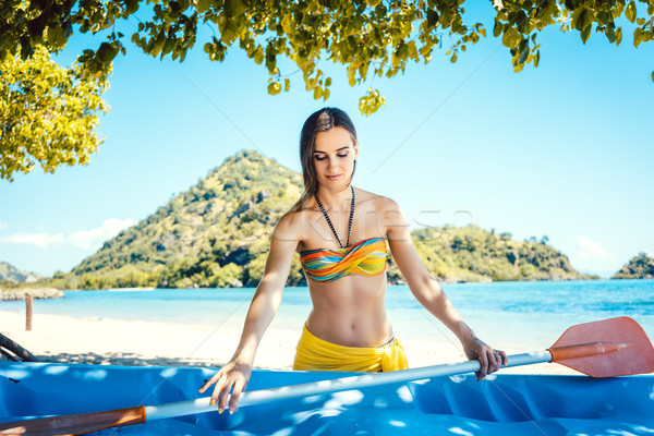 Woman with a kayak on an island in front of beach Stock photo © Kzenon