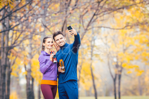 Athletic fitness couple taking selfie with their phone Stock photo © Kzenon