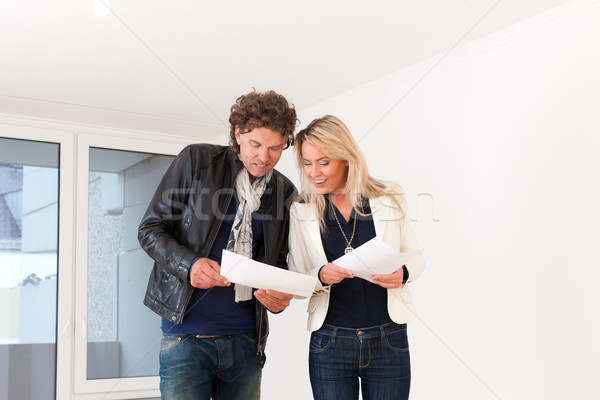 Young couple looking for real estate Stock photo © Kzenon