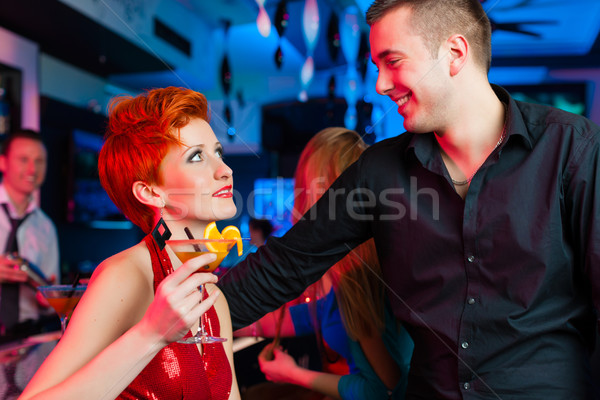 Young couple in bar or club drinking cocktails Stock photo © Kzenon