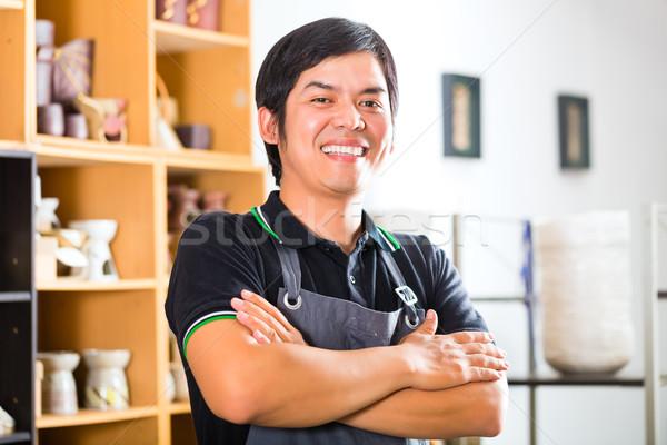 Asian Potter in his shop selling souveniers Stock photo © Kzenon