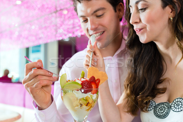 Young couple enjoying their time in ice cream parlor Stock photo © Kzenon
