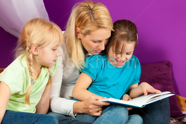Mother is reading a book Stock photo © Kzenon