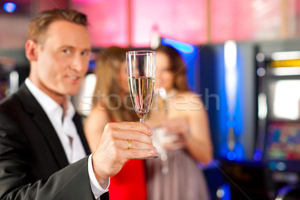 люди Бар три друзей шампанского казино Сток-фото © Kzenon