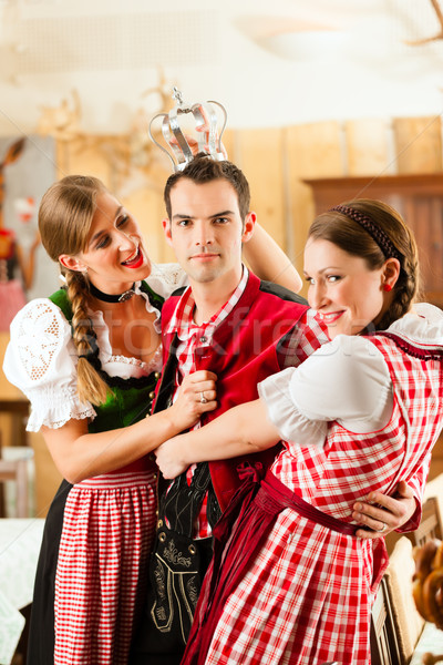 Young people in traditional Bavarian Tracht in restaurant or pub Stock photo © Kzenon