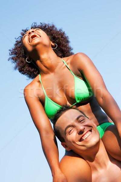 лет Бикини девушки сидят Плечи человека Сток-фото © Kzenon