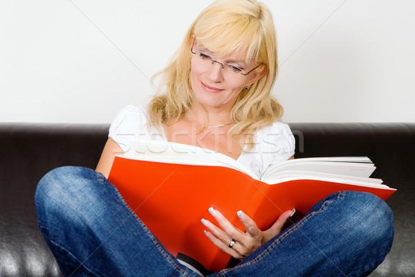 Cross legged reading Stock photo © Kzenon
